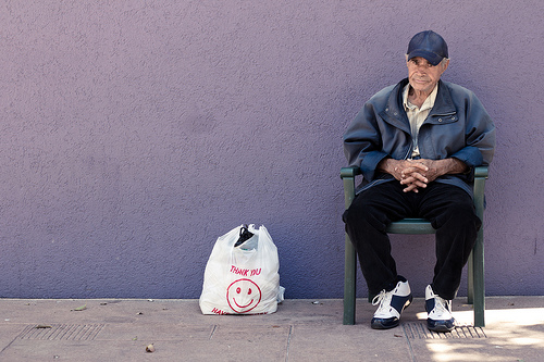 Old man with plastic bag