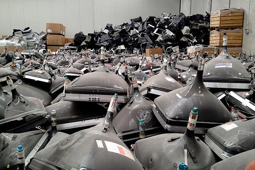 E-waste organized into piles